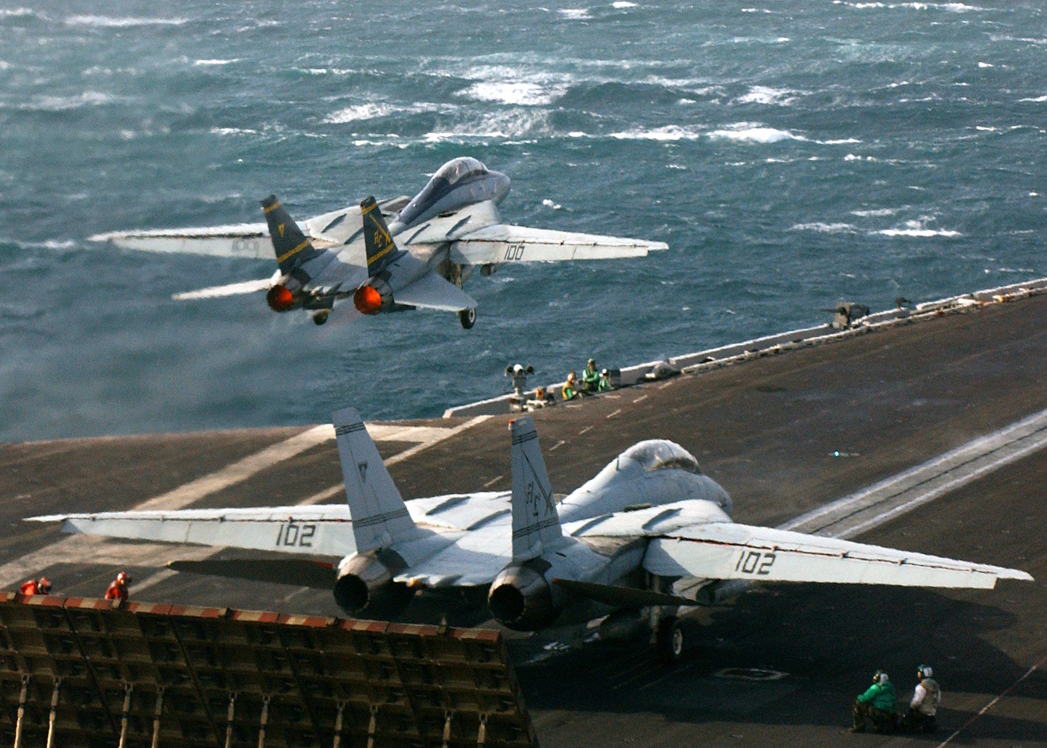 041123-N-5345W-015 Persian Gulf (Nov. 23, 2004) - An F-14B Tomcat assigned to the ÒSwordsmenÓ, of Fighter Squadron Three Two (VF-32), launches from one of the waist catapults as another Tomcat prepares to launch from the bow catapults on the flight deck of the Nimitz-class aircraft carrier USS Harry S. Truman (CVN 75).  Truman's Carrier Strike Group Ten (CSG-10) and her embarked Carrier Air Wing Three (CVW-3) is currently on deployment in support of the Global War On Terrorism. U.S. Navy photo by Photographers Mate Airman Kristopher Wilson (RELEASED)